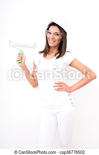 Beautiful young woman painting a Apartment - csp36776502