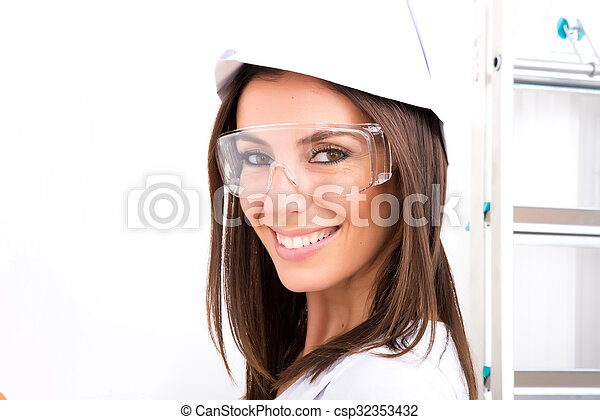 Beautiful young woman painting a Apartment - csp32353432