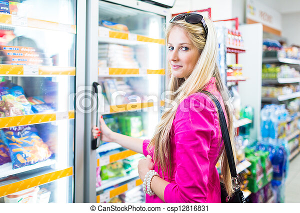 Beautiful young woman shopping in a grocery store/supermarket - csp12816831