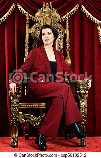 beautiful young woman sitting in vintage chair - csp56102512
