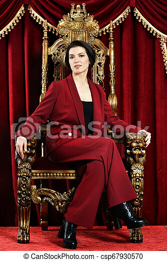 beautiful young woman sitting in vintage chair - csp67930570