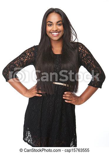 Beautiful young woman smiling in black dress - csp15763555
