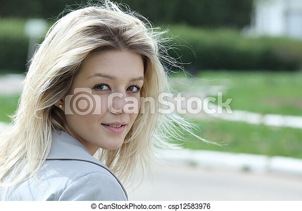 Beautiful young woman smiling. Outdoor portrait - csp12583976