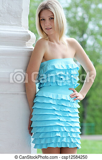 Beautiful young woman smiling. Outdoor portrait - csp12584250