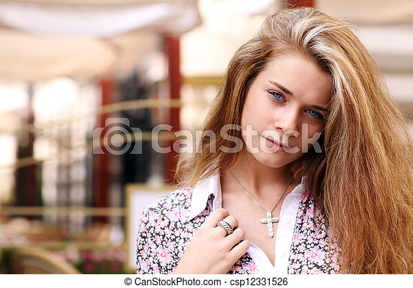 Beautiful young woman smiling. Outdoor portrait - csp12331526