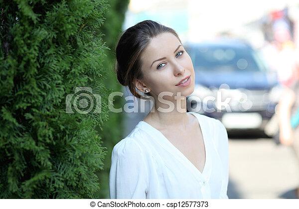 Beautiful young woman smiling - csp12577373