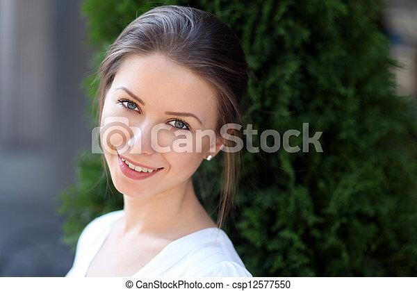 Beautiful young woman smiling - csp12577550