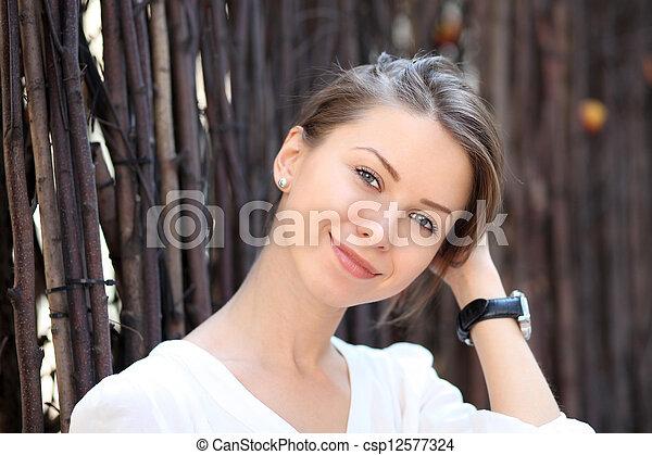Beautiful young woman smiling - csp12577324