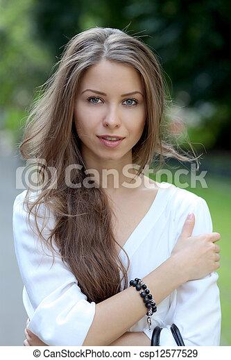 Beautiful young woman smiling - csp12577529