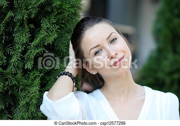 Beautiful young woman smiling - csp12577299