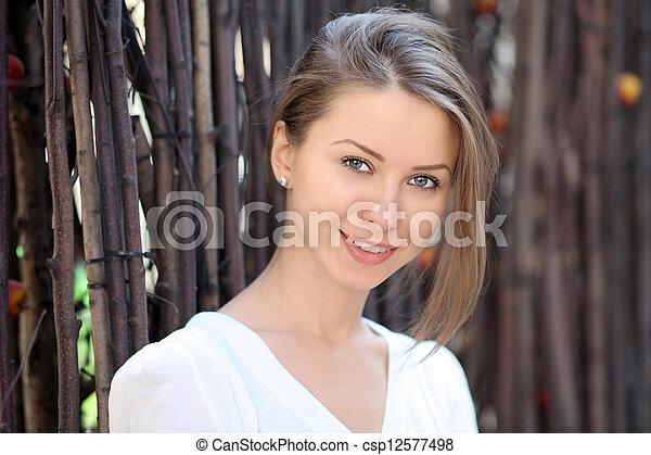 Beautiful young woman smiling - csp12577498