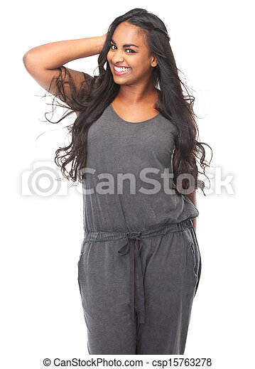 Beautiful young woman smiling with hand in hair - csp15763278