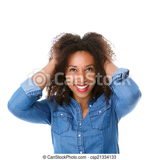 Beautiful young woman smiling with hand in hair - csp21334133