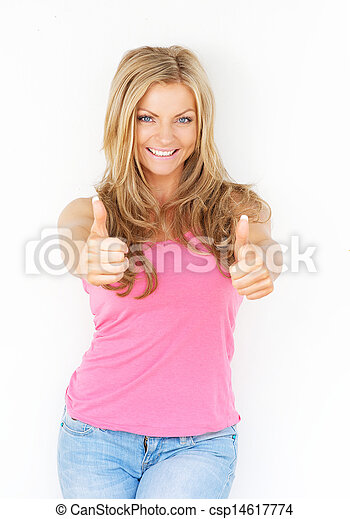 Beautiful young woman smiling with thumbs up - csp14617774