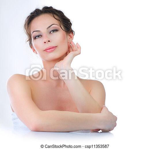 Beautiful Young Woman touching her Face. Skincare  - csp11353587