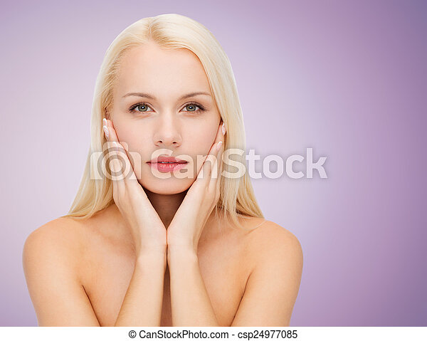 beautiful young woman touching her face - csp24977085