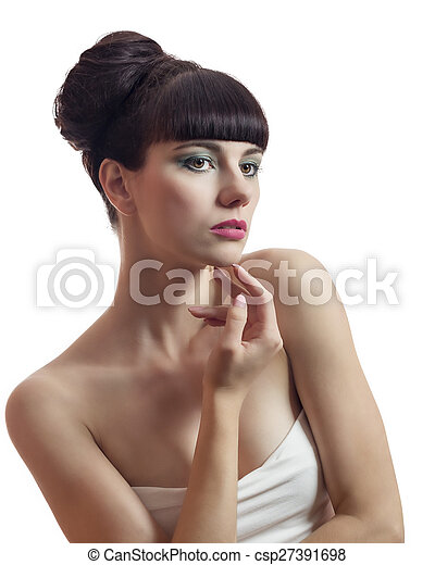 Beautiful Young Woman Touching Her Face - csp27391698