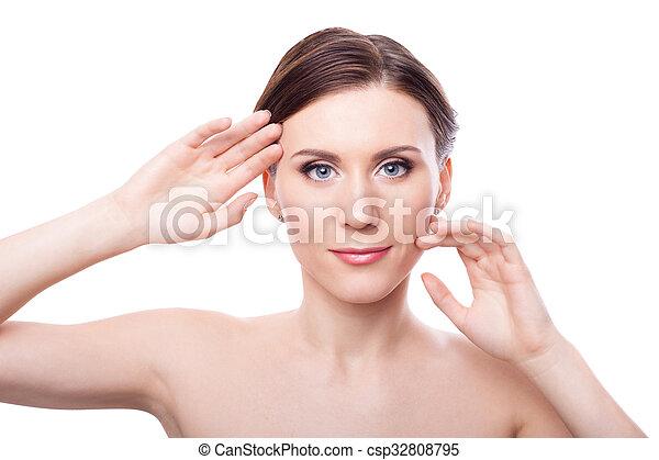 Beautiful Young Woman Touching Her Face - csp32808795
