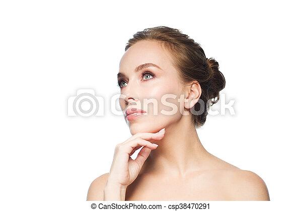 beautiful young woman touching her face - csp38470291