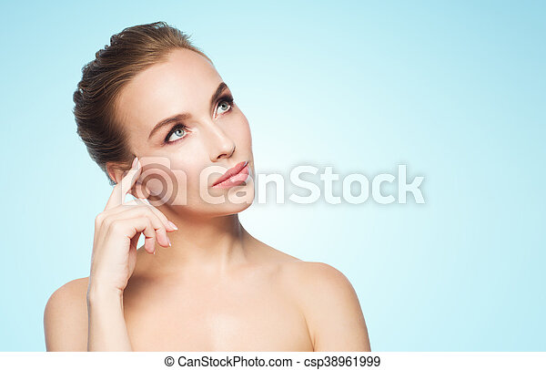 beautiful young woman touching her face - csp38961999