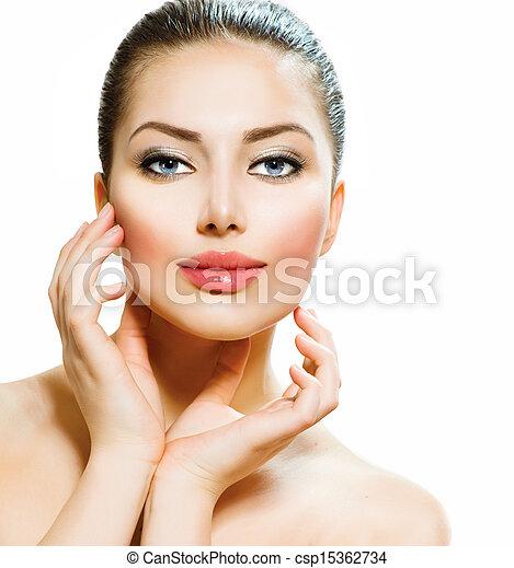 Beautiful Young Woman Touching Her Face  - csp15362734