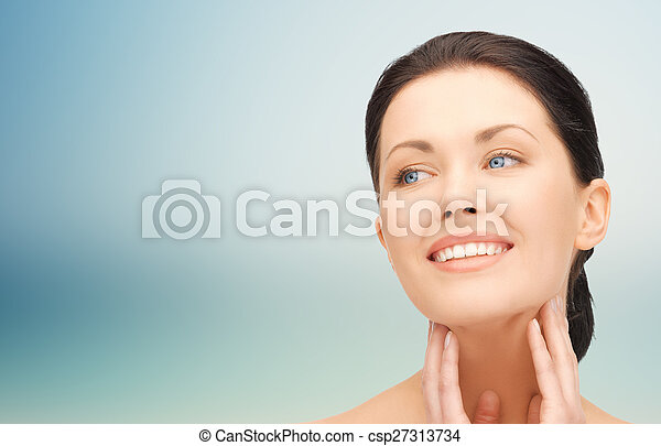 beautiful young woman touching her face and neck - csp27313734