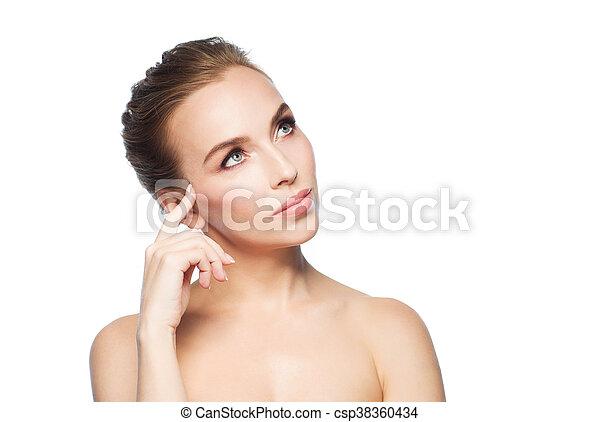 beautiful young woman touching her face - csp38360434