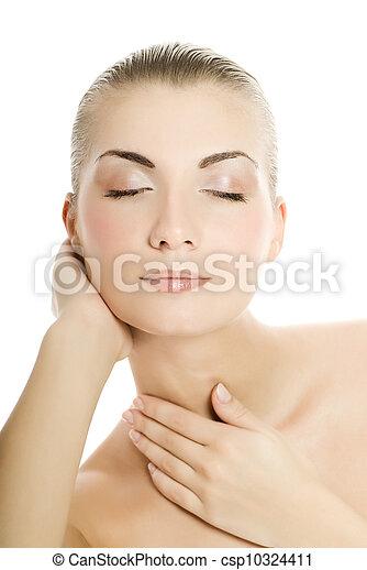 Beautiful young woman touching her skin - csp10324411