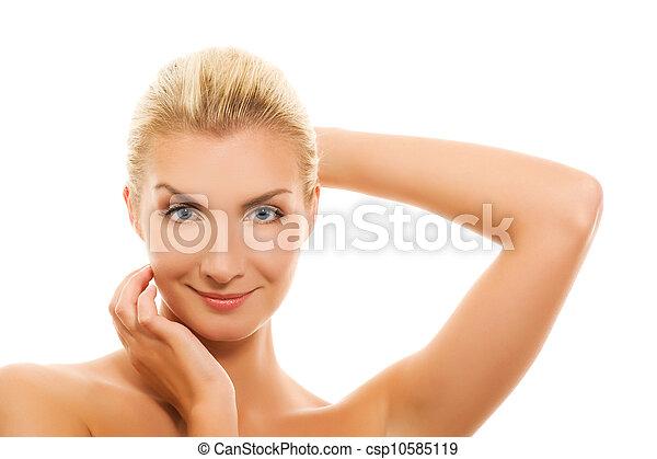 Beautiful young woman touching her skin - csp10585119