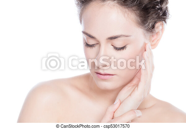 Beautiful young woman touching her skin. - csp53017570