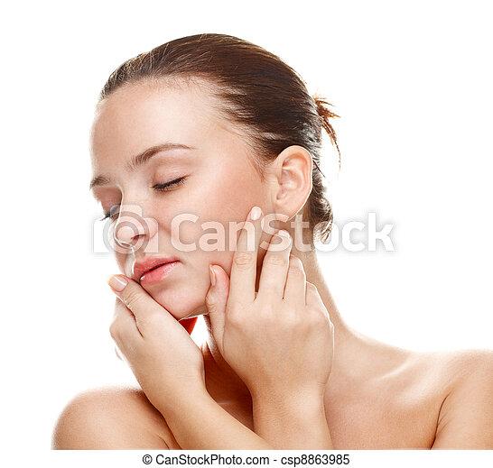 Beautiful young woman touching her skin. - csp8863985