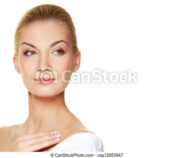 Beautiful young woman touching her skin - csp12053947