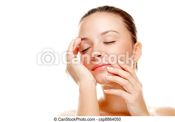 Beautiful young woman touching her skin. - csp8864050
