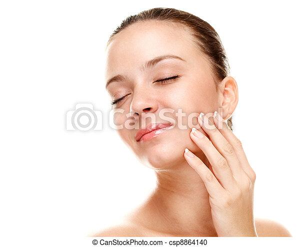 Beautiful young woman touching her skin. - csp8864140