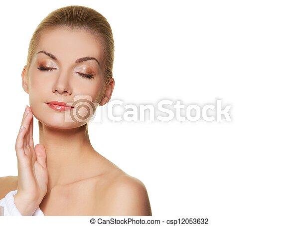 Beautiful young woman touching her skin - csp12053632