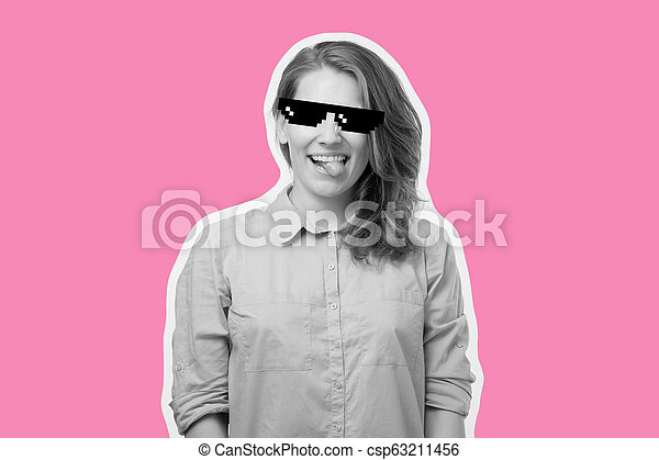 Beautiful young woman wearing sunglasses showing tongue with a surprise face is excited - csp63211456