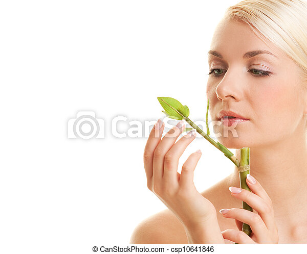 Beautiful young woman with a bamboo plant - csp10641846
