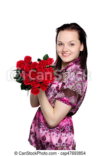 beautiful young woman with a bouquet of red roses - csp47693854