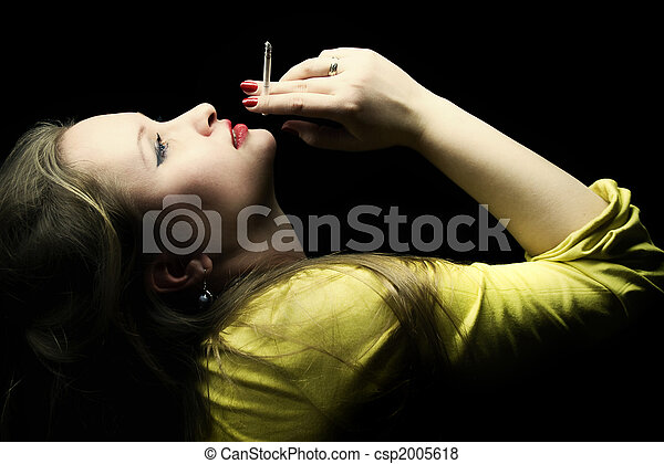 beautiful young woman with a cigarette in a hand - csp2005618