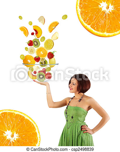 Beautiful young woman with a fruit salad - csp2498839