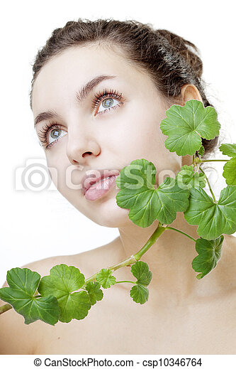 Beautiful young woman with a green plant - csp10346764