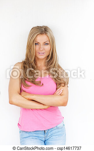 Beautiful young woman with arms crossed - csp14617737