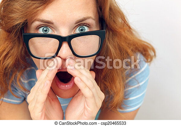 Beautiful young woman with black glasses surprised. - csp20465533