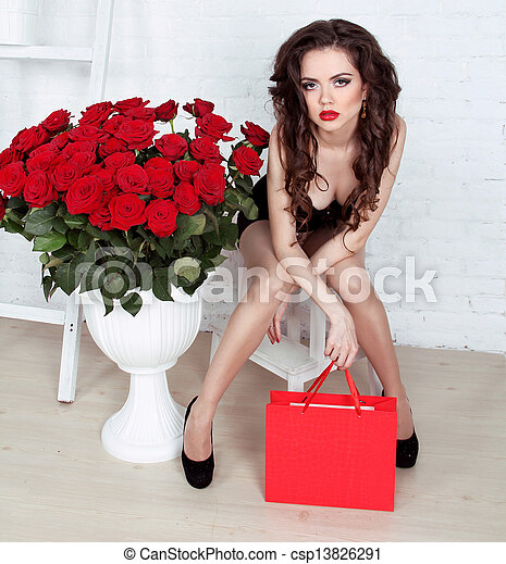 Beautiful young woman with bouquet of red roses and gift box, Valentine's day - csp13826291