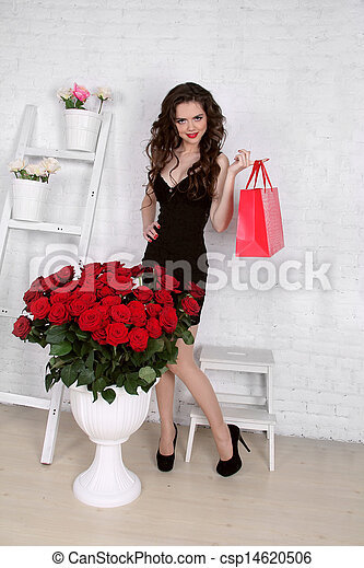 Beautiful young woman with bouquet of red roses and gift box, Valentine's day. - csp14620506