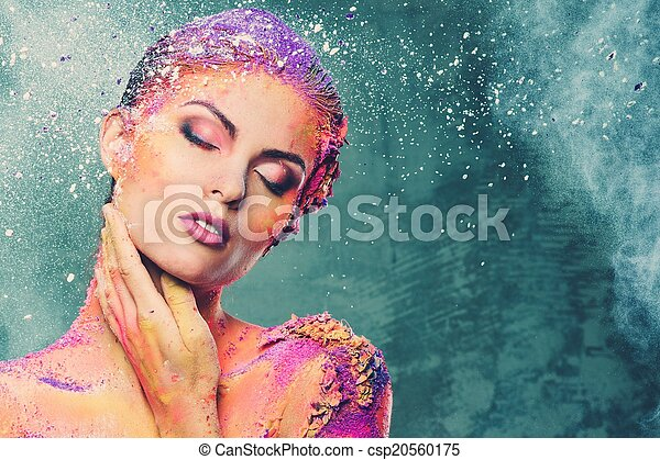 Beautiful young woman with conceptual colourful body art  - csp20560175