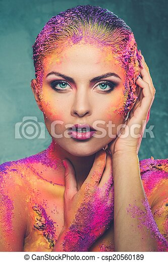 Beautiful young woman with conceptual colourful body art  - csp20560189