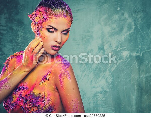 Beautiful young woman with conceptual colourful body art  - csp20560225