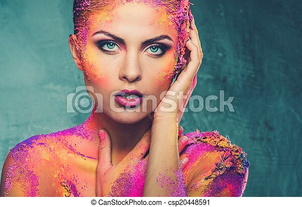 Beautiful young woman with conceptual colourful body art  - csp20448591