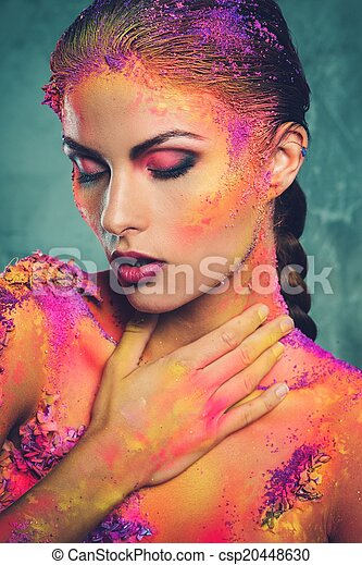 Beautiful young woman with conceptual colourful body art  - csp20448630